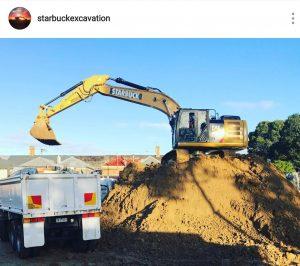 Cat excavator loading a truck