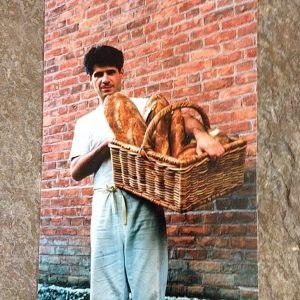 Richard Bourdon holding a basket of bread