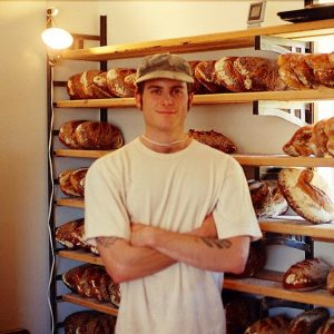Chad Robinson standing in front of a bread rack