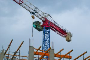 Raimondi flat top crane over top of a construction site